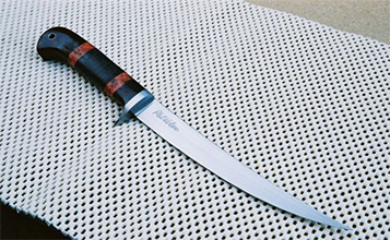 6 inch Punta Chivato with muti pc Desert Ironwood and contrasting           red stabilized wood spacers